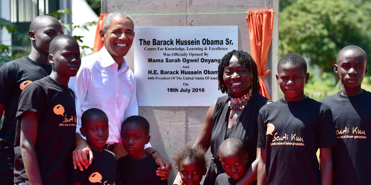 Image: Obama greets kids during the opening of the Sauti Kuu Resource Centre