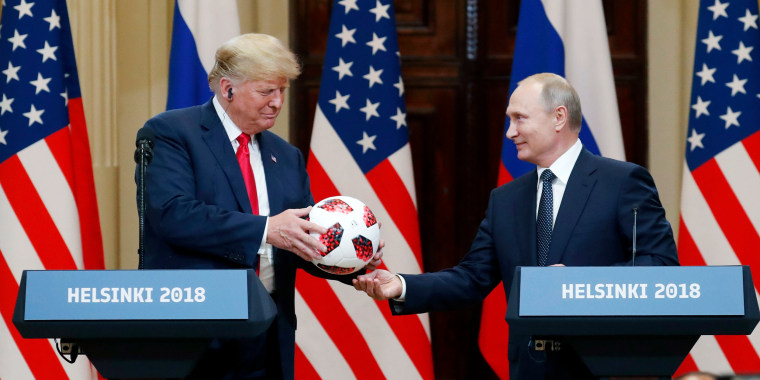 Image: President Donald Trump receives a soccer ball of the 2018 FIFA World Cup from Russian President Vladimir Putin