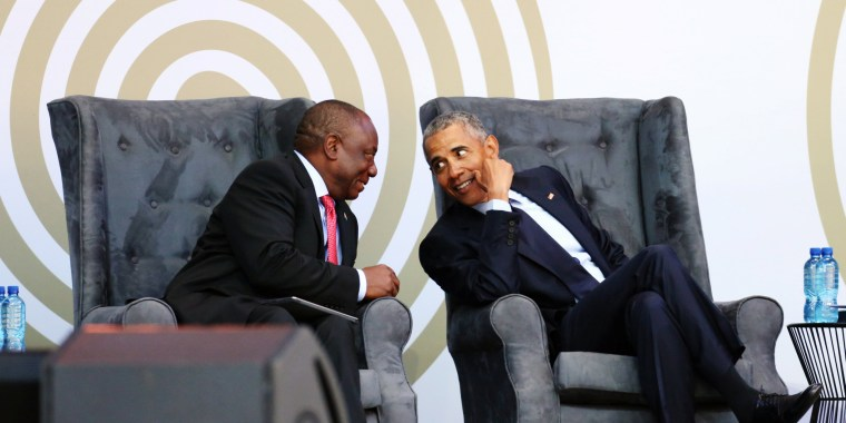 Image: South African President Cyril Ramaphosa talks to former U.S. President Barack Obama