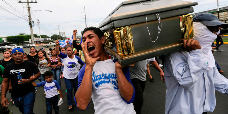 Image: Friends and relatives carry the coffin containing the body of the student Gerald Velazquez