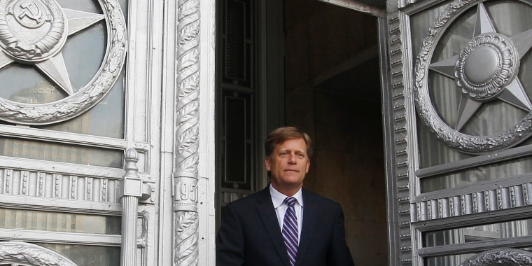 Image: U.S. Ambassador McFaul leaves Russian Foreign Ministry headquarters in Moscow