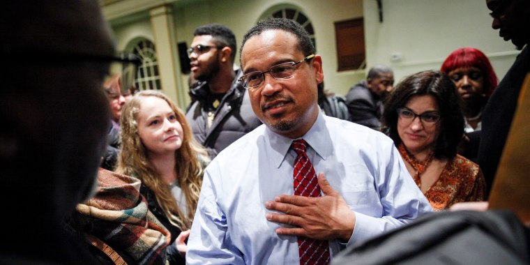 Image: Rep. Keith Ellison meets supporters after a town hall meeting