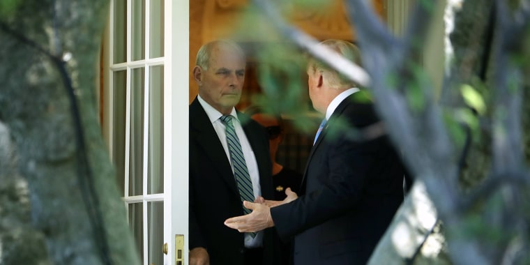Image: Trump talks with his Chief of Staff John Kelly before departing the White House