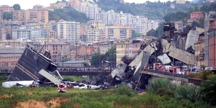 Image: A section of a giant highway bridge that collapsed in Genoa