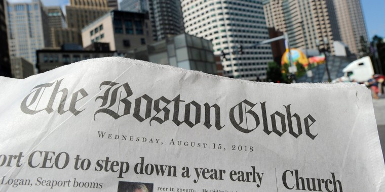 Boston Globe newspaper is seen with the Boston skyline