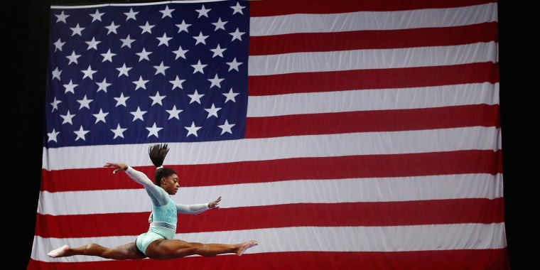 Image: Simone Biles competes on the balance beam
