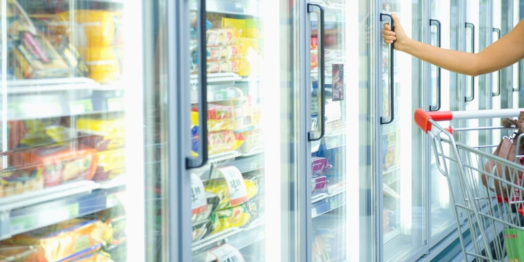 Image: A woman shops in the frozen food aisle