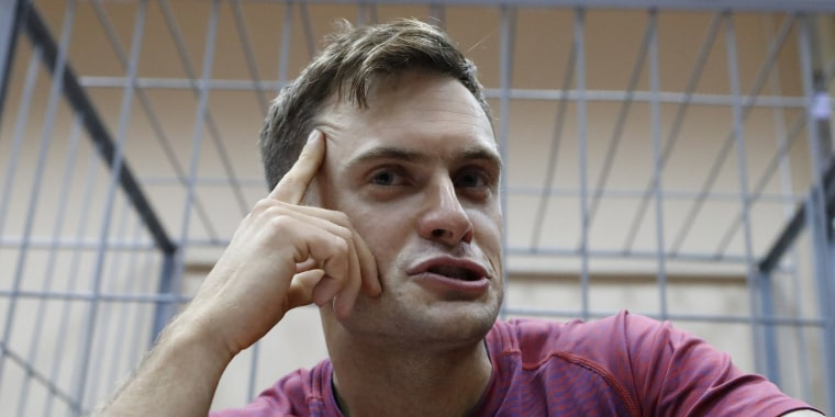 Image: Pyotr Verzilov an activist affiliated to anti-Kremlin punk band Pussy Riot attends a court hearing in Moscow
