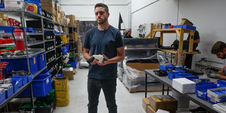 Image: Cody Wilson, owner of Defense Distributed company, holds a 3D printed gun, called the Liberator