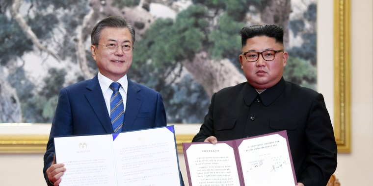 IMAGE: South Korean President Moon Jae-in and North Korean leader Kim Jong Un