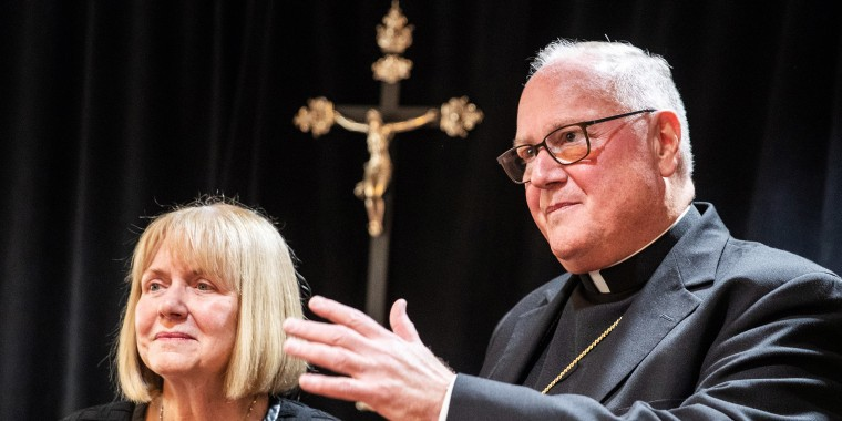 Image: Former judge in the U.S District Court for the Southern District of New York Barbara S. Jone and  Archbishop of New York Cardinal Timothy Dolan speas during a news conference in Manhattan