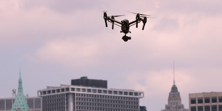 Image: A drone hovers in the sky during practice day at the National Drone Racing Championships