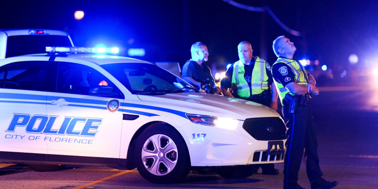 Image: Authorities direct traffic on Hoffmeyer Road near the Vintage Place neighborhood where several law enforcement officers were shot