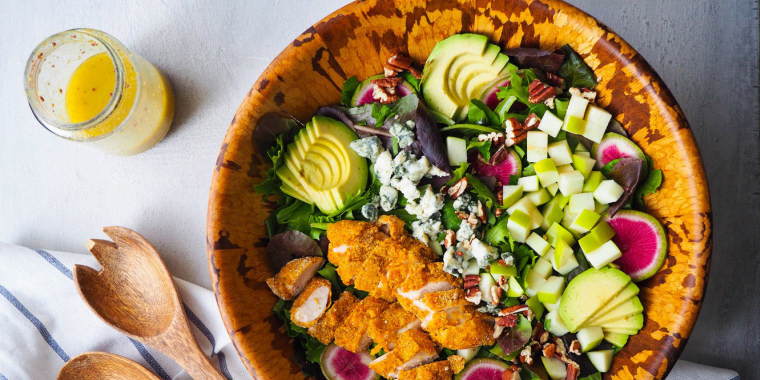 Give your salads a fall twist by adding sliced apples, like in this Harvest Salad with Crispy Cornmeal Chicken, Apples and Gorgonzola.
