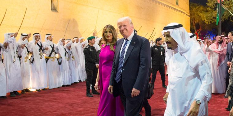 Image: Trump and first lady Melania Trump are welcomed by Saudi Arabia's King Salman bin Abdulaziz Al Saud at Al Murabba Palace in Riyadh