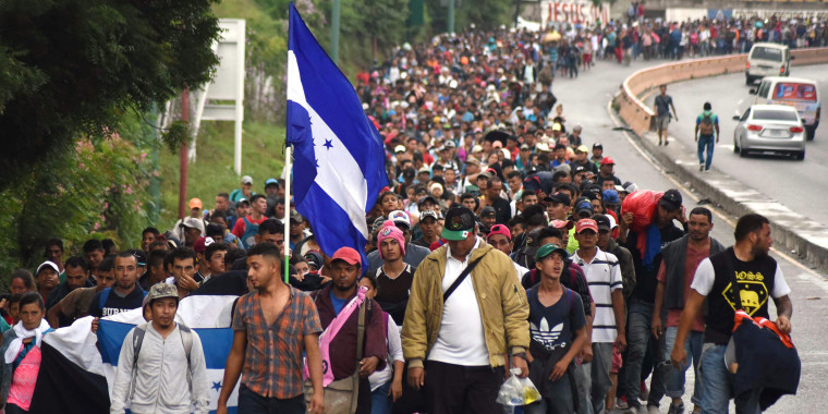 Honduran migrants walk towards the United States in Chiquimula, Guatemala on Oct. 17, 2018.  A migrant caravan set out on Oct. 13 from the impoverished, violence-plagued country and was headed north on the long journey through Guatemala and Mexico to the U.S. border.