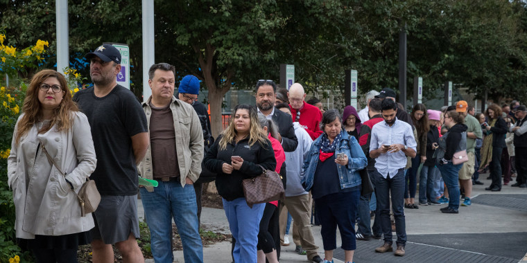 People wait in line to vote at a polling place on the first day of early voting on Oct. 22, 2018 in Houston, Texas.