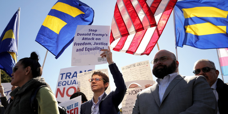 Activists from the National Center for Transgender Equality, partner organizations and their supporters hold a 'We Will Not Be Erased' rally in front of the White House on Monday.