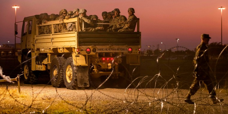 Image: Troops enter a compound near the U.S.-Mexico border crossing at Donna, Texas