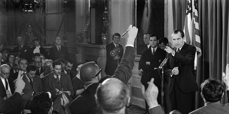 President Richard Nixon picks a questioner as newsmen vie for his attention during a televised news conference in the White House East Room March 14, 1969 in Washington.