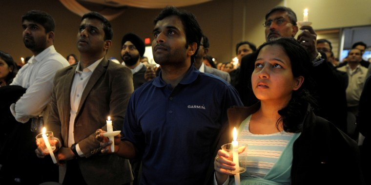 Alok Madasani, who was wounded in a bar shooting that killed Indian engineer Srinivas Kuchibhotla, sings during a candlelight vigil at a conference center in Olathe, Kansas