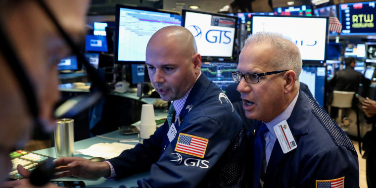 Traders work on the floor at the New York Stock Exchange in New York on Nov. 20, 2018.
