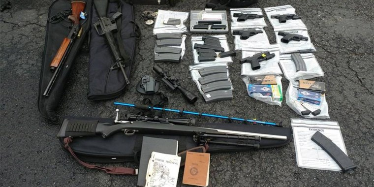 Authorities found several weapons and magazines of ammunition when they arrested Matthew Smith in Springfield, Kentucky, on Nov. 19, 2018.