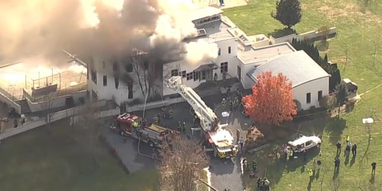 Firefighters at the scene of a fire in Colts Neck