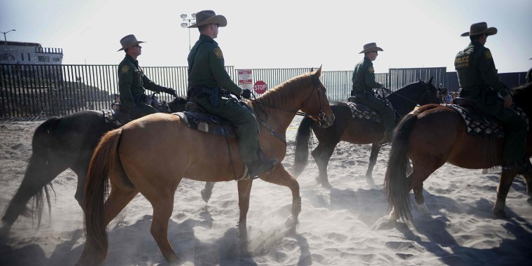 Tensions mounting as thousands gather at U.S.-Mexico border