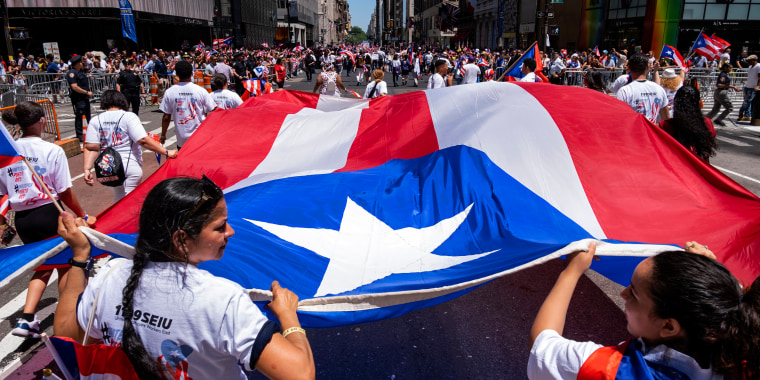 Image: People march in the Puerto Rican Day Parade on 5th Avenue in New York on June 9, 2019.