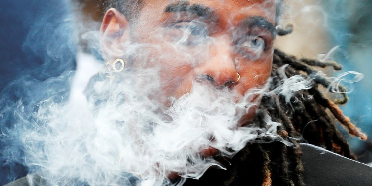 Image: FILE PHOTO: A demonstrator vapes during a protest in Boston