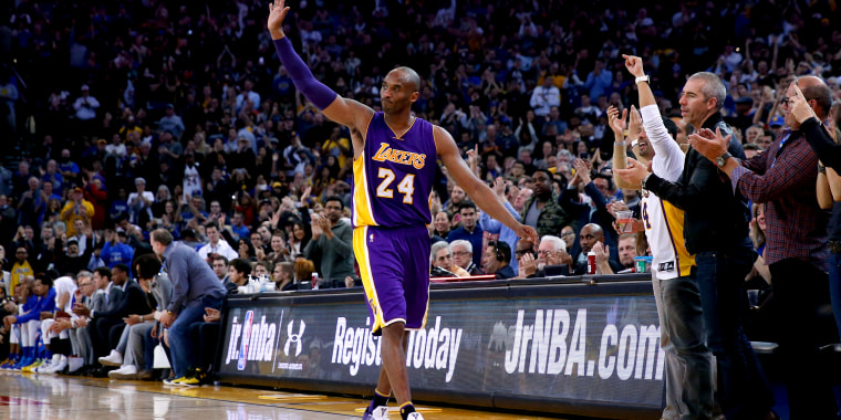 Image: Kobe Bryant of the Los Angeles Lakers waves to the crowd after being taken out of the game in the fourth quarter against the Golden State Warriors at ORACLE Arena on January 14, 2016 in Oakland.