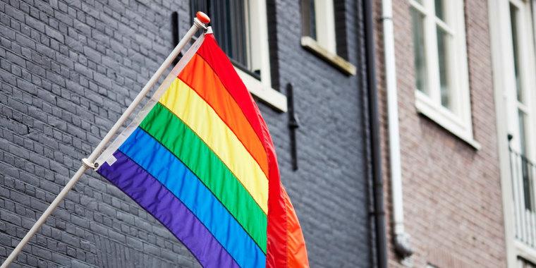 LGBTQ+ flag flying on building