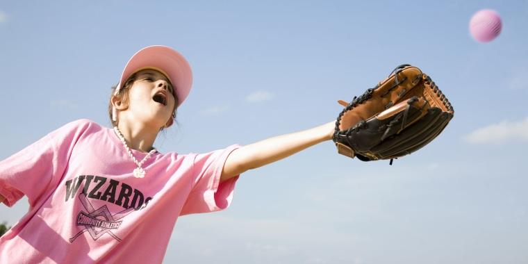 Young Girl Playing Softball