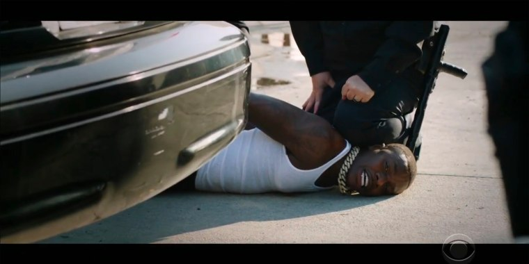 """Rapper DaBaby performs """"Rockstar"""" as an actor playing a police officer presses his knee on DaBaby's neck, replicating the last few moments of George Floyd's life, during the BET Awards on Sunday night, June 28, 2020."""