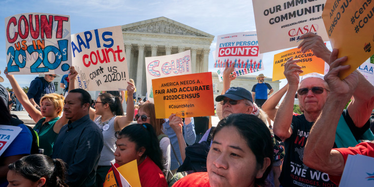 Image: Immigration activists rally outside the Supreme Court during arguments over a Trump administration plan to ask about citizenship on the 2020 Census on April 23, 2019.