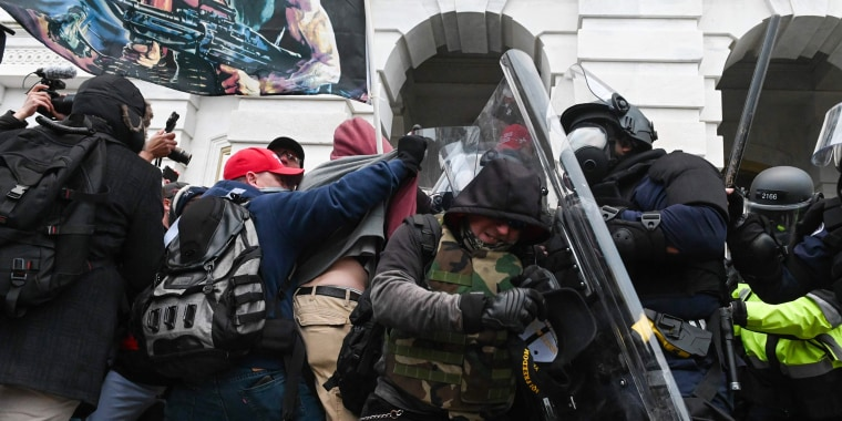 Image: Police push back rioters after they stormed the Capitol on Jan. 6, 2021