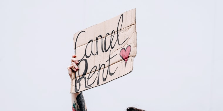 "A demonstrator holds a sign that reads ""Cancel Rent\"" during an eviction strike in the Brooklyn borough of New York on Sept. 1, 2020."