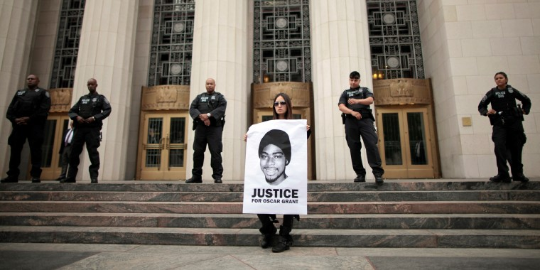 Sheena Chou, 28, protests against the early release of Johannes Mehserle outside the U.S. Department of Justice in Los Angeles