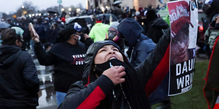 Image: FILE PHOTO: Protesters rally outside Brooklyn Center Police Department a day after Daunte Wright was shot and killed by a police officer, in Brooklyn Center, Minnesota
