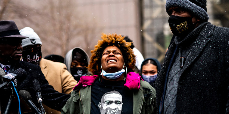 Image: Naisha Wright, Daunte Wright's aunt, with members of George Floyd's family during a press conference outside the Hennepin County Government Center on April 13, 2021 in Minneapolis.