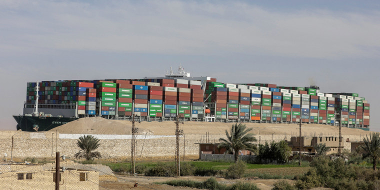 Image: Ship Ever Given, one of the world's largest container ships, is seen after it was fully floated in Suez Canal, Egypt