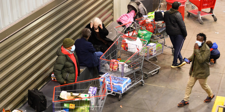 People shop for groceries at Costco in New York on Nov. 24, 2020.