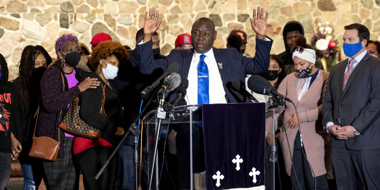 Image: Floyd and Wright families attorney Ben Crump speaks, flanked by the family of Daunte Wright, during a press conference at New Salem Missionary Church in Minneapolis on April 15, 2021.