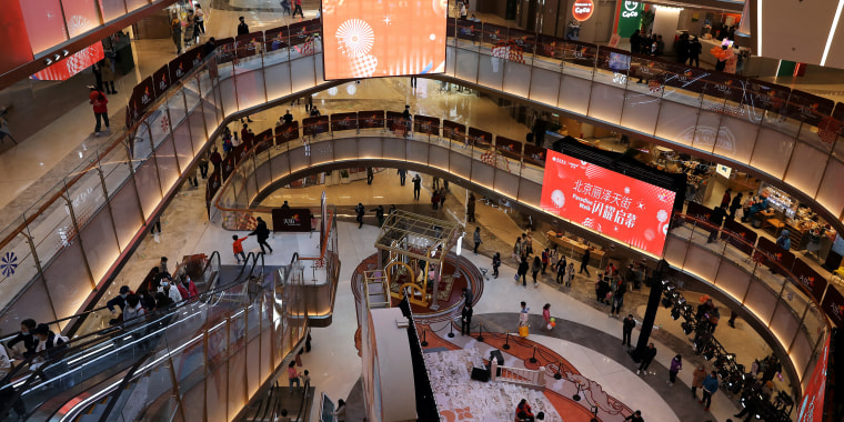 Image: People visit a newly opened shopping mall in Beijing, China