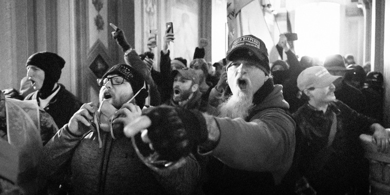 Image: Supporters of President Donald Trump, including Jon Schaffer, pointing his finger at right, protest inside the Capitol on Jan. 6, 2021.
