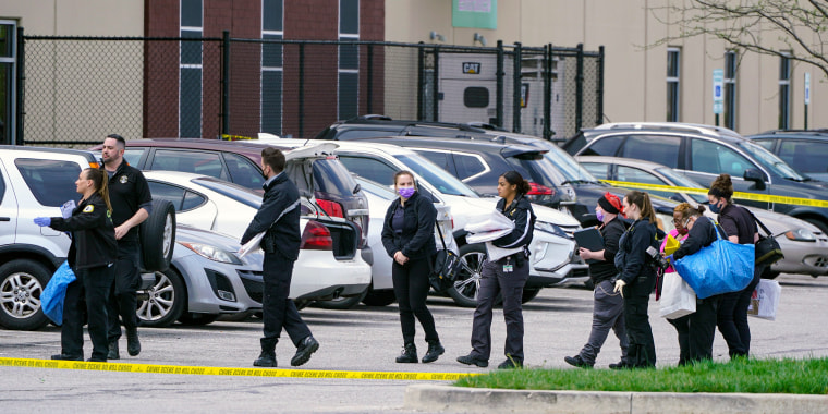 Image: Law enforcement confer at the scene on April 16, 2021, in Indianapolis, where multiple people were shot at a FedEx Ground facility near the Indianapolis airport.