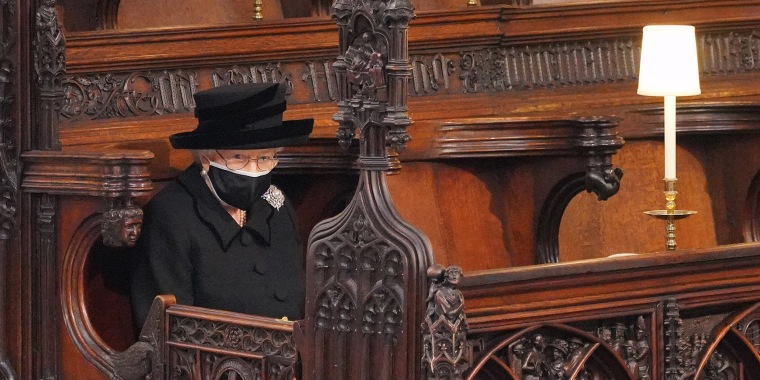 Image: Queen Elizabeth II takes her seat during the funeral of Prince Philip, Duke of Edinburgh in St George's Chapel at Windsor Castl