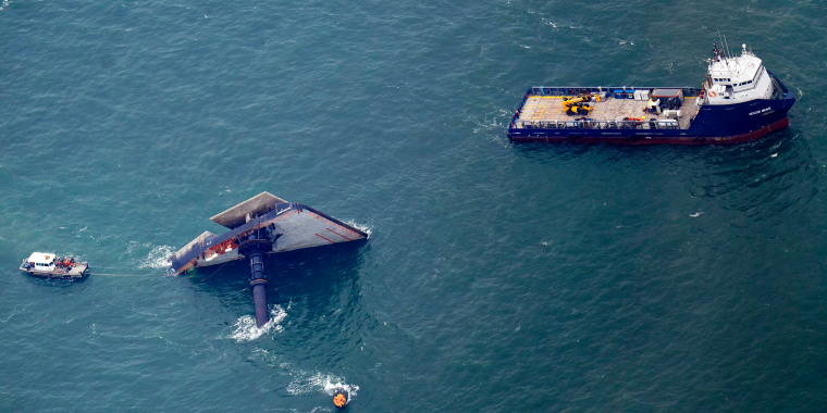 Image: Rescue boats are seen next to the capsized lift boat Seacor Power seven miles off the coast of Louisiana in the Gulf of Mexico on April 18, 2021.
