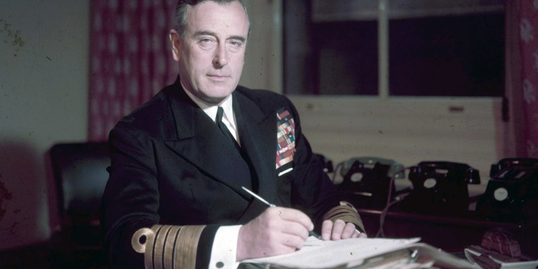 Image: First Sea Lord Louis Mountbatten, Earl Mountbatten, at his office in the Admiralty